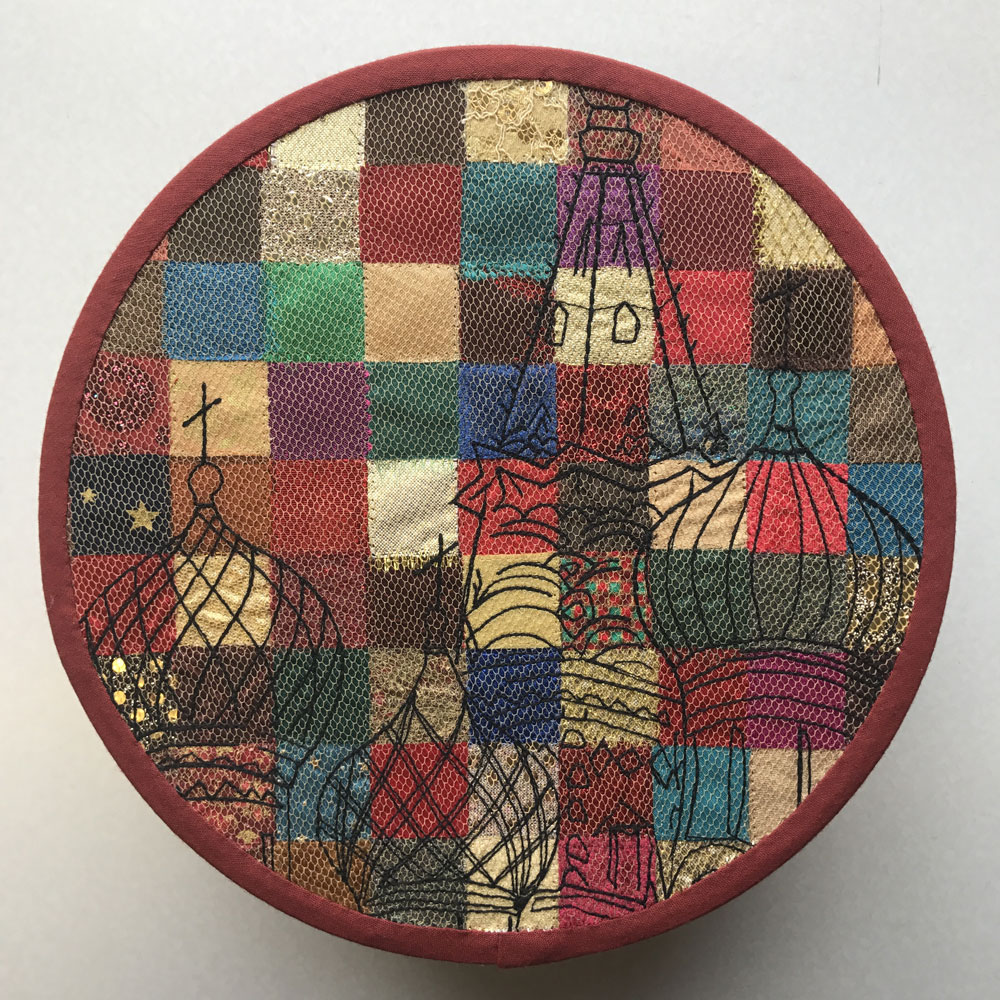 Embroidered patchwork quilt design