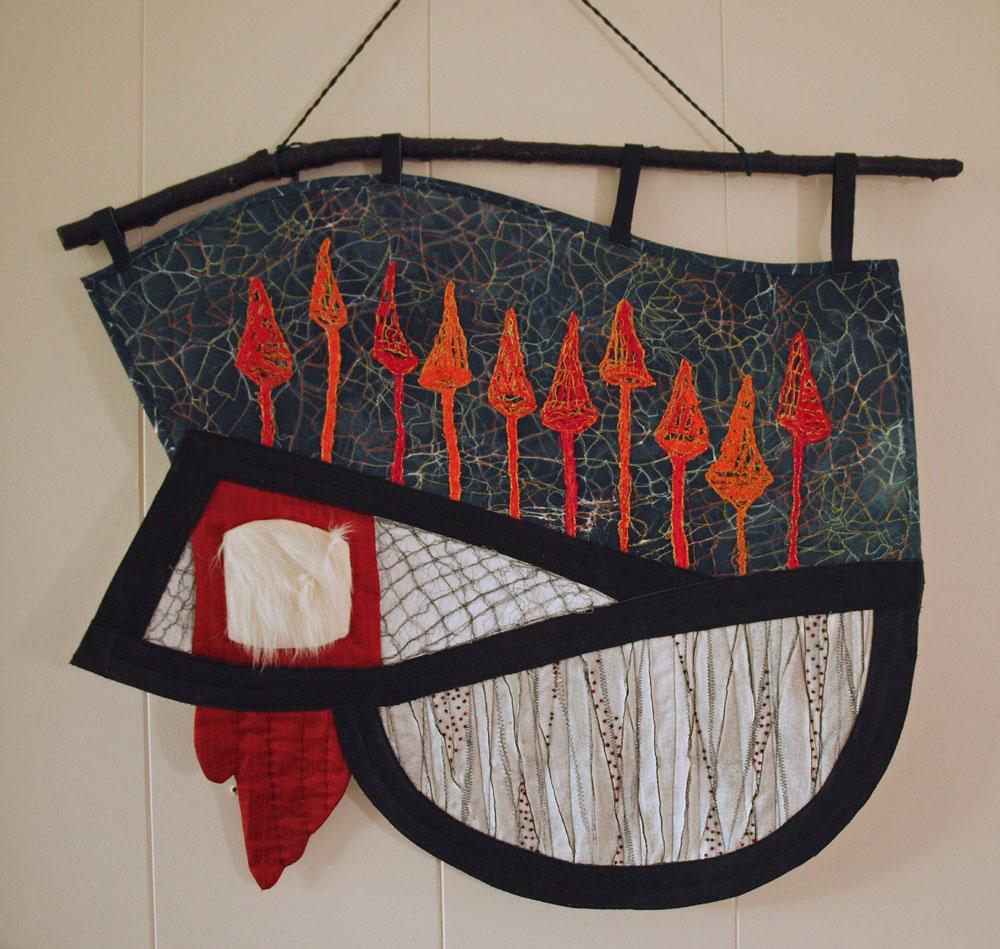 Handing art by textiles artist Greta Huseboe