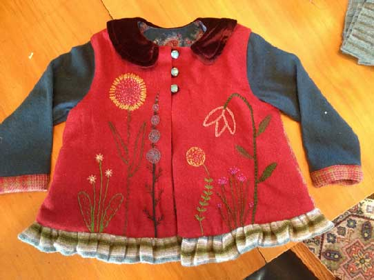 A hand embroidered jacket designed and created by Jennifer Brown