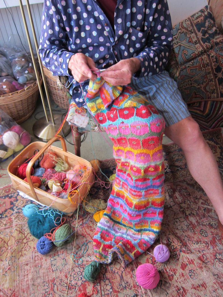 Kaffe Fasset knitting in his workshop