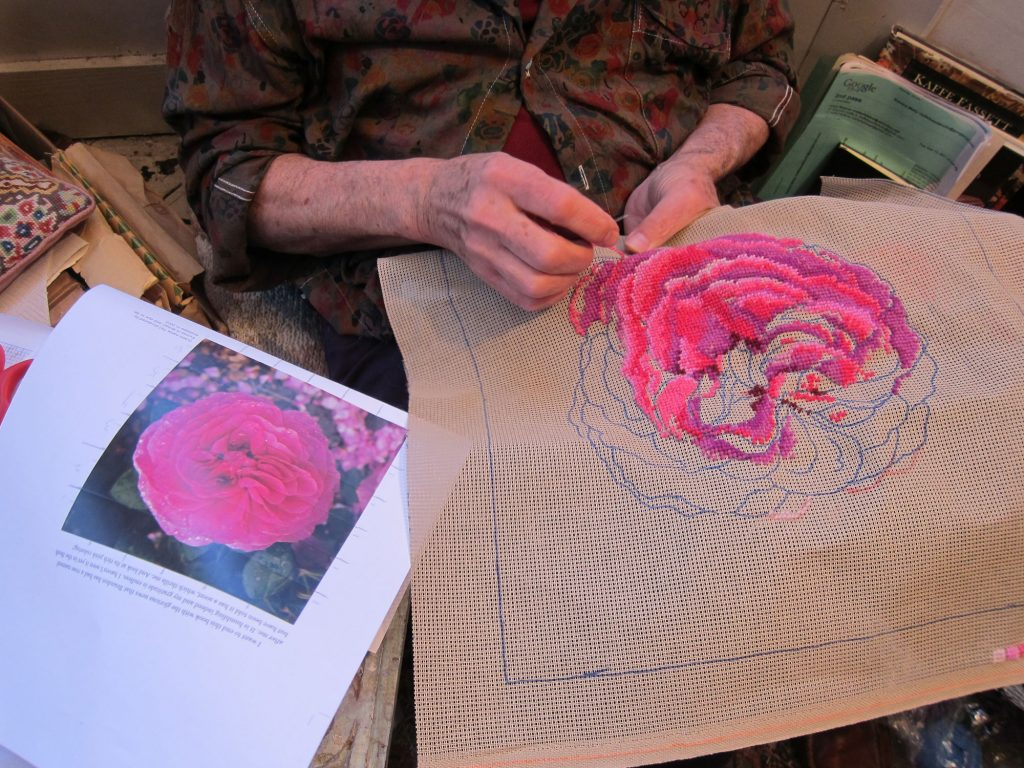 Rose needlepoint in progress by Kaffe Fassett