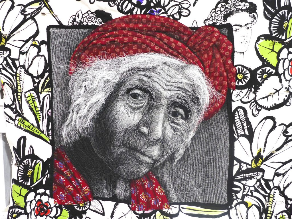 Quilt created by Pam Holland inspired by her own photograph taken of an elderly woman