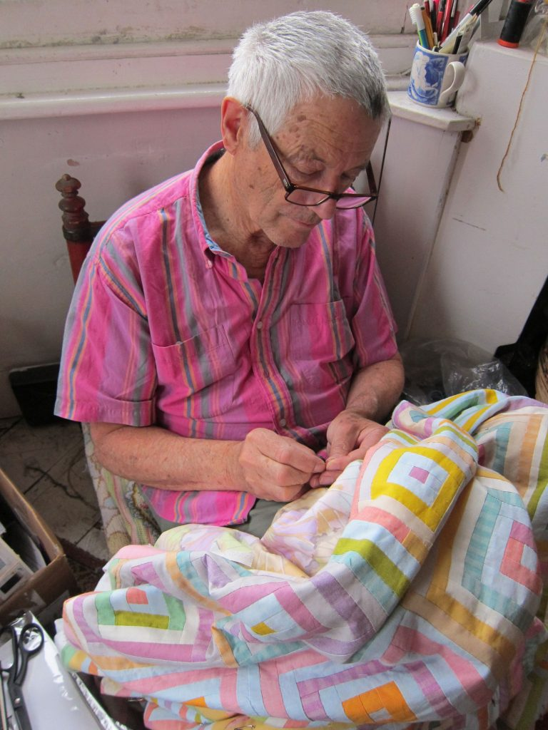 Kaffe Fassett working on a quilt