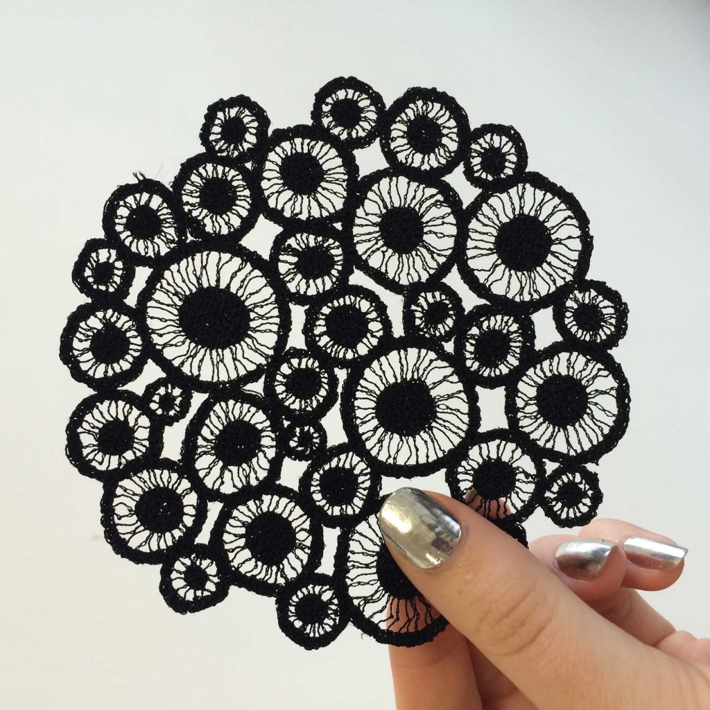 Tiny black piece embroidered by Meredith Woolnough