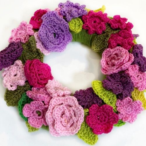 Learn how to crochet this 3d crochet ring made of crocheted flowers