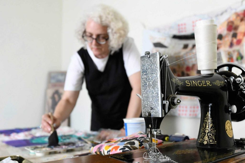 Anne Kelly at work in her studio in Kent