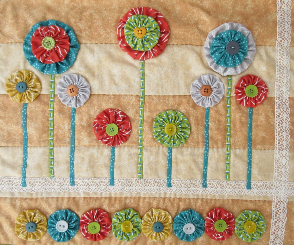 Patchwork and Quilting design with Suffolk Puffs