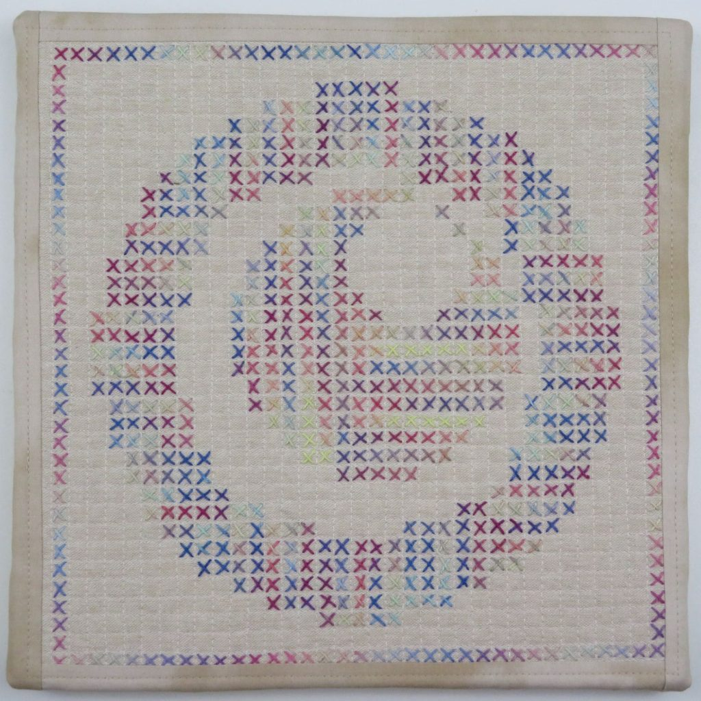 Hand stitched squares by Catherine Redford