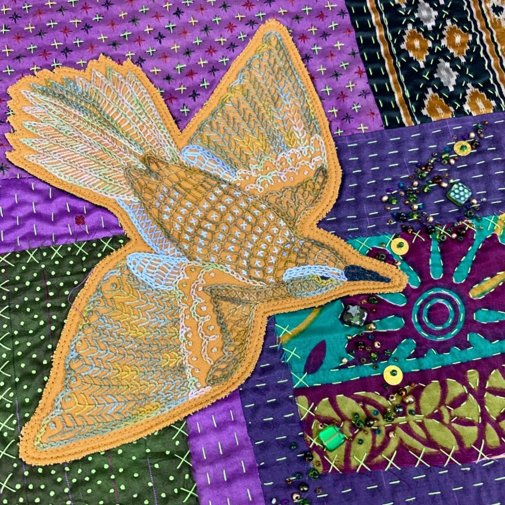 Hand embroidered design added to Patchwork Quilt